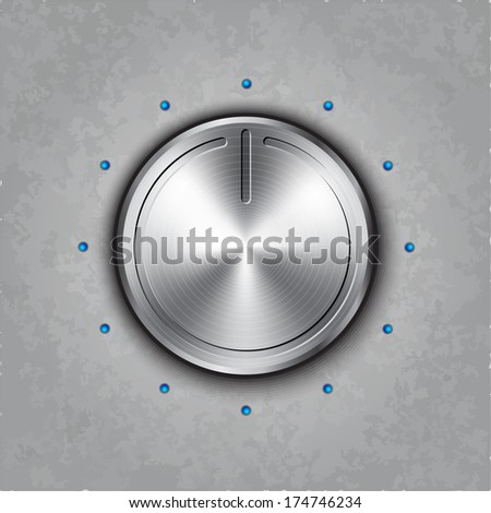 round metal power button on textured background