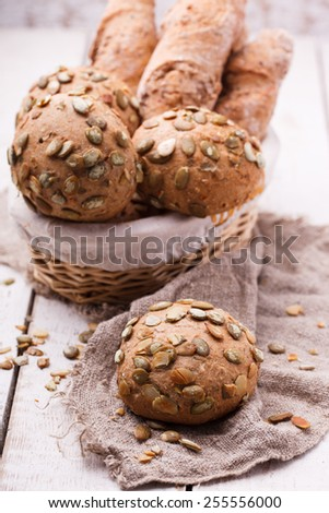 Round sandwich bun with sunflower seeds from bran. - stock photo