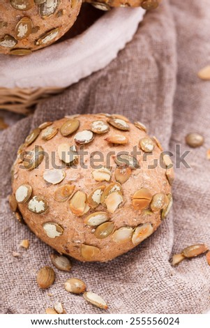 Round sandwich bun with sunflower seeds from bran.selective focus - stock photo