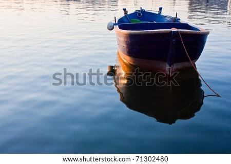 ,rowboat in sea, - stock photo