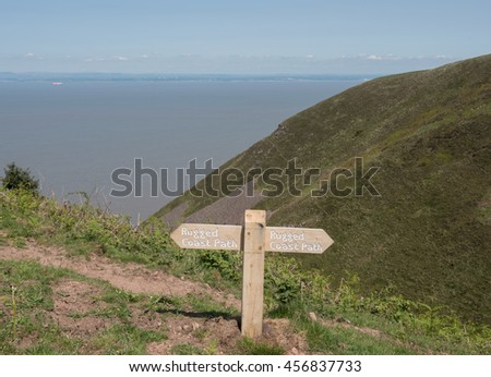 """Rugged Coast Path"" Sign on North Hill with Views Across the Bristol Channel to Wales on the South West Coastal Path in Somerset, England, UK"