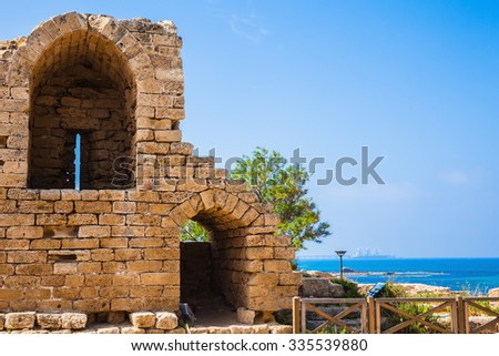Ruins of ancient defensive walls and urban facilities. National park Caesarea on the Mediterranean. Israel - stock photo