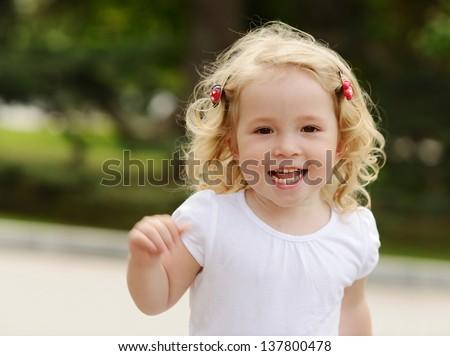running toddler girl in motion - stock photo