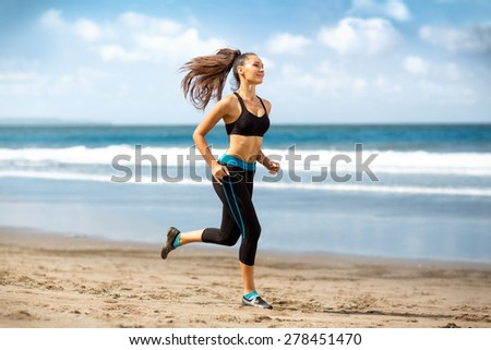 Running woman, female runner jogging during outdoor workout on beach., fitness model outdoors. - stock photo