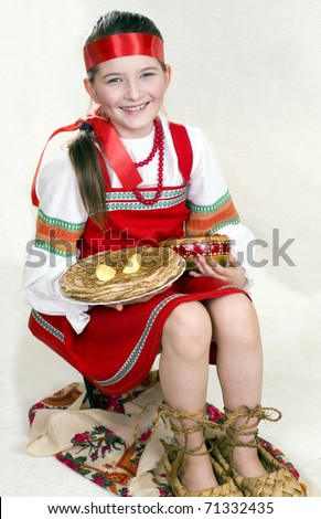 Russian girl national clothes and the big bast shoes. A pancake week - stock photo