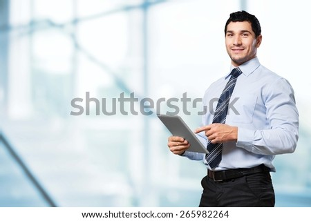 30s. Businessman With Digital Tablet In Warehouse - stock photo