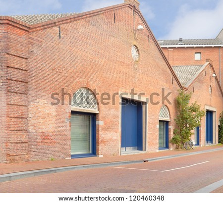 1800s former warehouse in Amsterdam, the Netherlands, as an example of Dutch vintage industrial architecture - stock photo