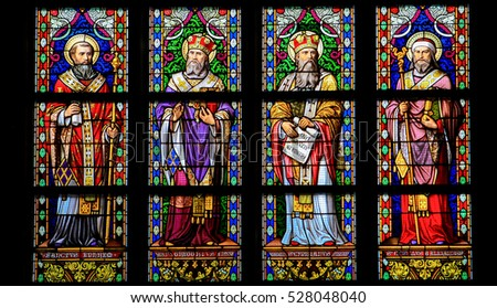 'S HERTOGENBOSCH, THE NETHERLANDS - JULY 23, 2011: Saints Ephrem, Gregogrius, Cyprianus and Cyrillus - Stained Glass in Den Bosch Cathedral.