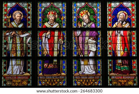 'S HERTOGENBOSCH, THE NETHERLANDS - JULY 23, 2011: Stained Glass Window depicting Saint Basil of Caesarea, Gregory of Nazianzus, John Chrysostom and Athanasius of Alexandria in Den Bosch Cathedral. - stock photo
