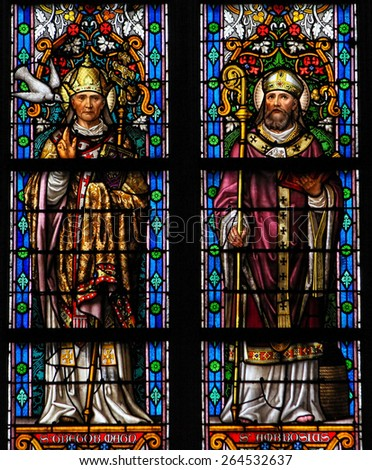 'S HERTOGENBOSCH, THE NETHERLANDS - JULY 23, 2011: Stained Glass Window depicting Saint Gregorius and Saint Ambrosius in Den Bosch Cathedral, North Brabant.