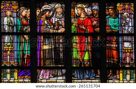 'S HERTOGENBOSCH, THE NETHERLANDS - JULY 23, 2011: Stained Glass Window depicting the Sacrament of Holy Matrimony, with Pepin of Landen and Itesberga united in marriage, in Den Bosch Cathedral. - stock photo