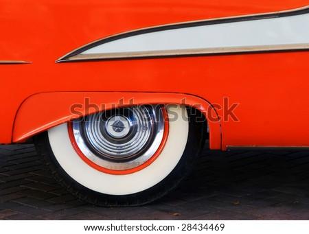 1950's orange car and tire - stock photo
