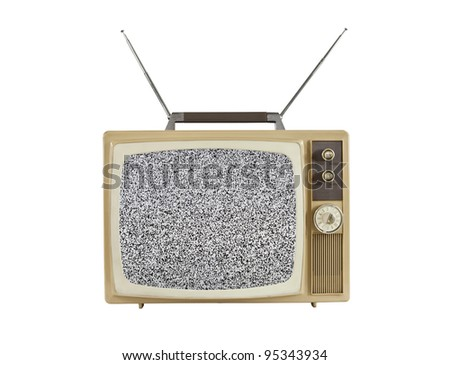 1960's portable television with static screen and antennas up.  Isolated on white. - stock photo
