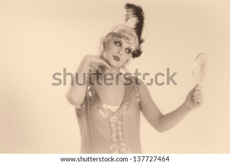 1920's style flapper girl in sepia tone - stock photo