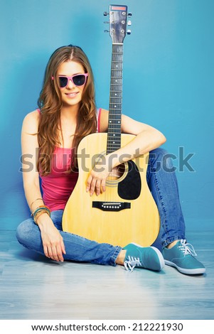 60s style photo of young hippIe woman . musician girl - stock photo
