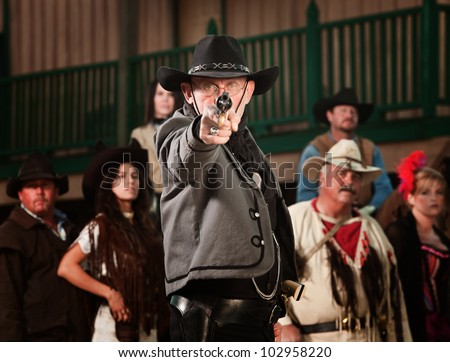 1800's western sheriff with gun drawn at point blank range - stock photo