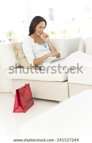 40s woman relaxing at home - stock photo