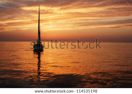 sailing boat in the sun set