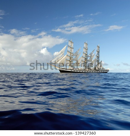 sailing ship on the waves - stock photo