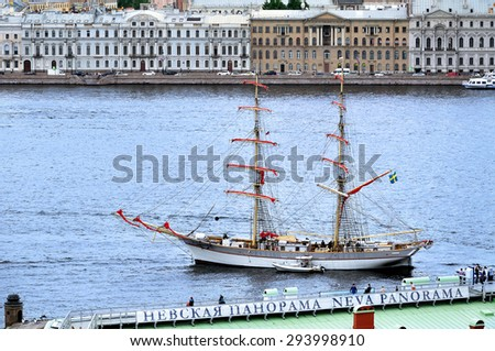 "SAINT-PETERSBURG, RUSSIA - JUNE 19, 2015. Swedish brig ""Tre Kronor"" with retracted Scarlet sails at the pier on the Neva river - bird's-eye view"