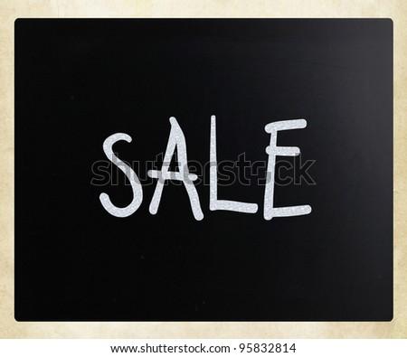 """Sale"" handwritten with white chalk on a blackboard - stock photo"