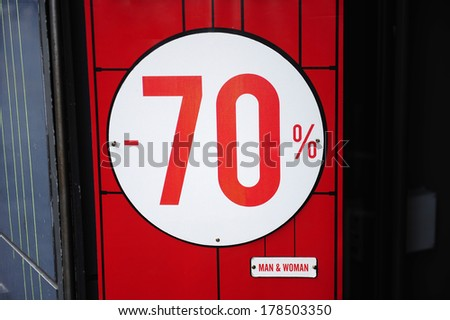 70% sale sign on a shop window - stock photo