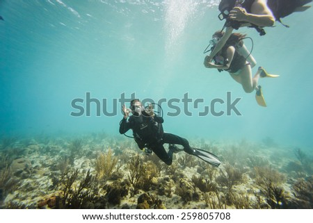 - San Andres, Colombia, January 10th 2014. San Andres is a coral island in the Caribbean Sea where lots of Tourists come for Scuba Diving and free Diving. Scuba diver doing the okay sign. - stock photo
