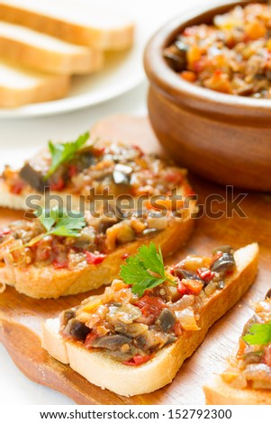 sandwiches with eggplant caviar and parsley leaves  - stock photo