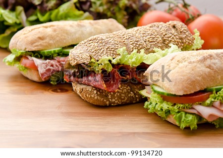 3 sandwiches with various healthy ingredients - stock photo