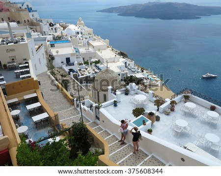 18.06.2015, Santorini, Greece. Romantic beautiful cityscape, restaurants and blue sea. - stock photo