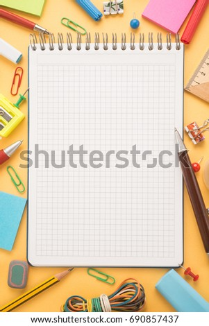 School office supplies on a yellow background