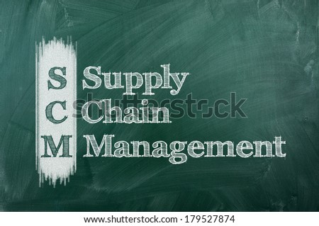 SCM Supply Chain Management  acronym written on chalkboard blackboard.