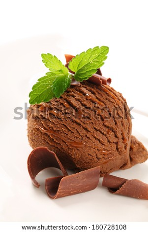 Scoop of chocolate ice cream decorated fresh mint