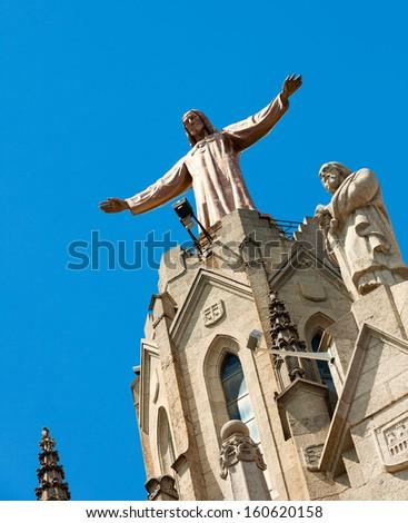 Sculpture of Jesus on top of Temple of Sagrat Cor at Tibidabo in  Barcelona, Spain - stock photo
