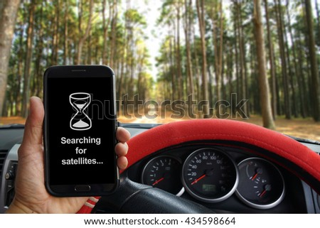 """""""Searching for Satellites"""" showing on the smartphone inside of a pickup truck. a pickup truck - stock photo"""