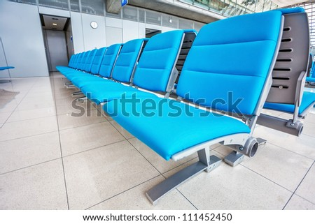 seats at the modern airport in waiting lounge - stock photo