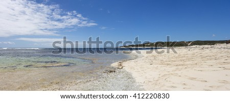 Secluded scenic view of the tide ebbing out from the   famous white sandy  surfing beach  at Margaret River South Western Australia  on a calm cloudy afternoon in  early summer . - stock photo