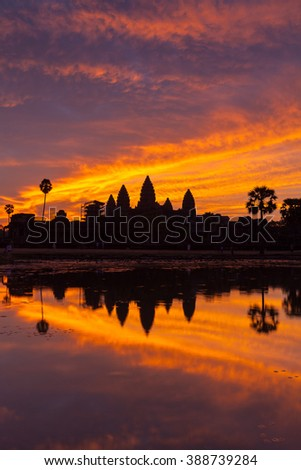 'See Angkor Wat and Die' is the true! I visited here and see the beautiful sunrise with dramatic sky and the silhouette of Angkor Wat. This was one of the most beautiful sunrise I have ever seen. - stock photo