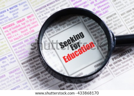 """Seeking For Education"" red and black text on blurry image of newspaper with magnifying glass on it symbolic as search"