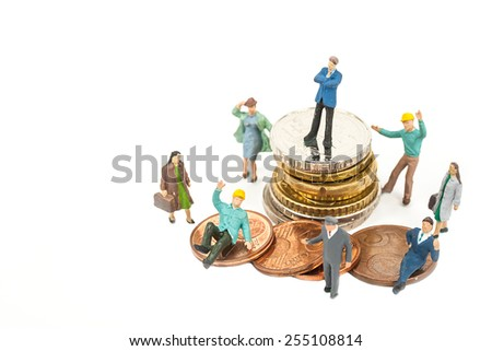selective focus photo of miniature business man in blue suit standing on euro coins on white background, abstract background to money and saving concept. - stock photo