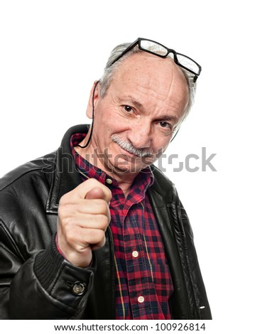Senior man showing the fig. Emotional portrait isolated on white
