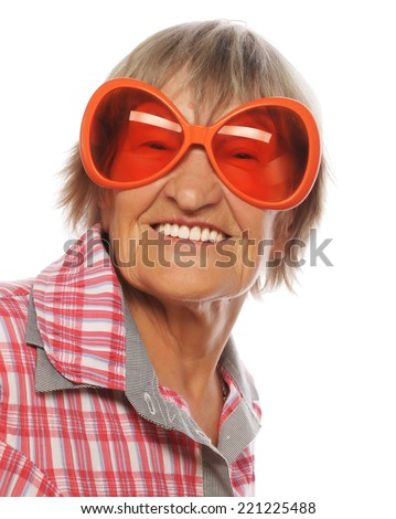 Senior woman wearing big sunglasses doing funky action isolated on white background  - stock photo