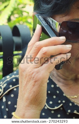Senior women talking phone
