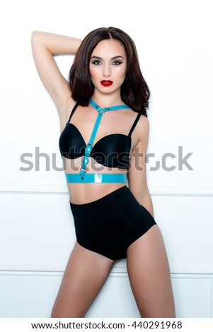 sensual brunette woman with perfect sexy lingerie on white background  - stock photo