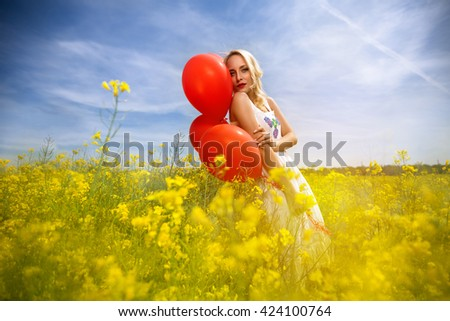 Sensual woman in yellow flowers enjoy in spring day  - stock photo