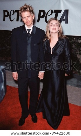 18SEP99: Actress ALICIA SILVERSTONE & boyfriend CHRISTOPHER JERECKI at PETA's Party of the Century, in Los Angeles.       Paul Smith / Featureflash