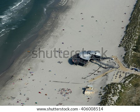 4 September 2014, Buren, Ameland, The Netherlands. Aerial view of a beach club at the Waddenzee at the Dutch island, Ameland. The building has the shape of a flying saucer.