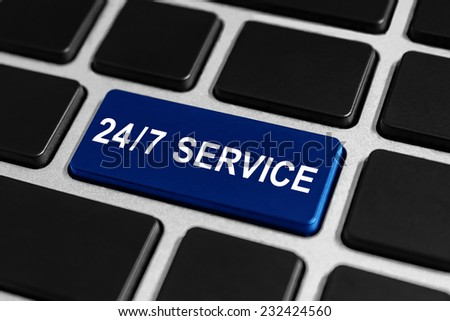 24/7 service blue button on keyboard, business concept - stock photo