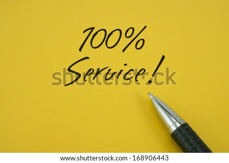 100% Service note with pen on yellow background