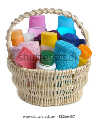 set of toiletries in basket isolated  on white background - stock photo